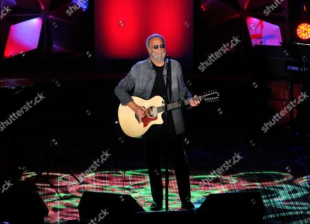 Yusuf Islam performs on stage at the 50th annual Songwriters Hall of Fame induction and awards ceremony at the New York Marriott Marquis Hotel, in New York