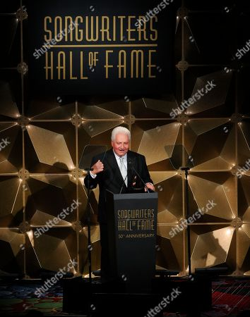 Martin Bandier speaks on stage at the 50th annual Songwriters Hall of Fame induction and awards ceremony at the New York Marriott Marquis Hotel, in New York