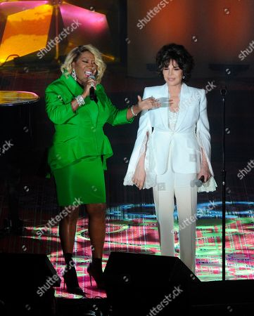 Patti LaBelle, Carole Bayer Sager. Patti LaBelle, left, and Carole Bayer Sager perform on stage at the 50th annual Songwriters Hall of Fame induction and awards ceremony at the New York Marriott Marquis Hotel, in New York