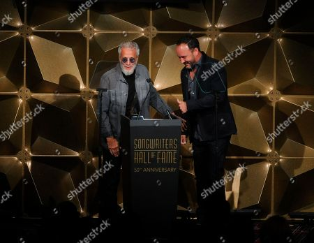 Dave Matthews ; Yusuf Islam. Yusuf Islam, left, and Dave Matthews speak on stage at the 50th annual Songwriters Hall of Fame induction and awards ceremony at the New York Marriott Marquis Hotel, in New York