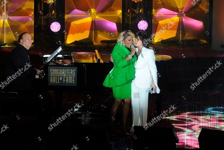 Patti LaBelle; Carole Bayer Sager. Patti LaBelle and Carole Bayer Sager perform at the 50th annual Songwriters Hall of Fame induction and awards ceremony at the New York Marriott Marquis Hotel, in New York