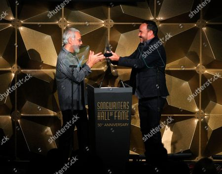 Dave Matthews; Yusuf Islam. Yusuf Islam and Dave Matthews on stage at the 50th annual Songwriters Hall of Fame induction and awards ceremony at the New York Marriott Marquis Hotel, in New York