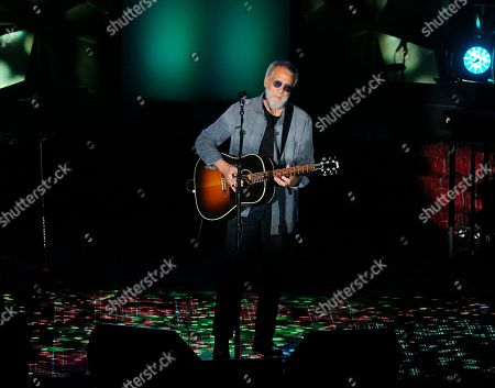 Stock Photo of Yusuf Islam performs on stage at the 50th annual Songwriters Hall of Fame induction and awards ceremony at the New York Marriott Marquis Hotel, in New York