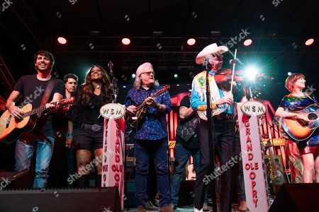 Morgan Evans, Wendy Moten, Ricky Skaggs, Woody Paul, Molly Tuttle. Morgan Evans, from left, Wendy Moten, Ricky Skaggs, Woody Paul, and Molly Tuttle perform during the Grand Ole Opry performance at the Bonnaroo Music and Arts Festival, in Manchester, Tenn