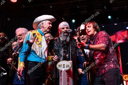 Woody Paul, Steve Earle, Joey Miskulin, Charlie Worsham. Woody Paul, from left, Steve Earle, Joey Miskulin, and Charlie Worsham perform during the Grand Ole Opry performance at the Bonnaroo Music and Arts Festival, in Manchester, Tenn