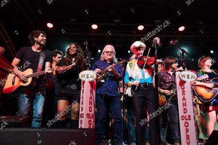 Morgan Evans, Wendy Moten, Ricky Skaggs, Woody Paul, Charlie Worsham, Molly Tuttle. Morgan Evans, from left, Wendy Moten, Ricky Skaggs, Woody Paul, Charlie Worsham, and Molly Tuttle perform during the Grand Ole Opry performance at the Bonnaroo Music and Arts Festival, in Manchester, Tenn