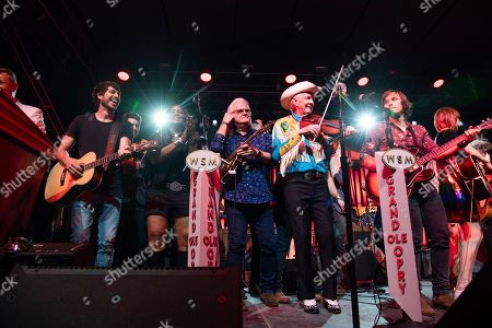Morgan Evans, Wendy Moten, Ricky Skaggs, Woody Paul, Charlie Worsham. Morgan Evans, from left, Wendy Moten, Ricky Skaggs, Woody Paul, and Charlie Worsham perform during the Grand Ole Opry performance at the Bonnaroo Music and Arts Festival, in Manchester, Tenn