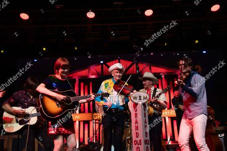 Woody Paul, Molly Tuttle, Ranger Doug, Ketch Secor. Woody Paul, from left, Molly Tuttle, Ranger Doug, and Ketch Secor performs during the Grand Ole Opry performance at the Bonnaroo Music and Arts Festival, in Manchester, Tenn