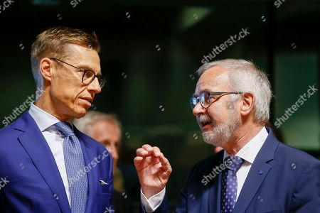 The Vice President of European Investment Bank Alexander Stubb (L) and President of the European Investment Bank (EIB), Werner Hoyer (R) at the start of the ECOFIN Finance Ministers meeting in Luxembourg, 14 June 2019. EU Finance ministers will discuss the taxation and financial aspects of the 'Clean Planet for all' communication by the Commission and the country specific recommendations of the 2019 European Semester.