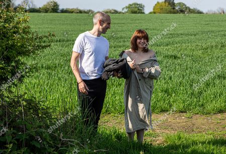 Ep 8522 Tuesday 2nd July 2019 - 1st Ep Sam Dingle, as played by James Hooton, and Lydia, as played by Karen Blick, streak across Home Farm field, while Megan and Priya watch agape, having caught sight of them from afar.