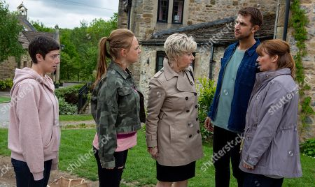 Ep 8522 Tuesday 2nd July 2019 - 1st Ep Victoria Sugden, as played by Isobel Hodgins, Diane Sudden, as played by Elizabeth Estensen, & Amy Wyatt, as played by Natalie Ann Jamieson, spot Lee, as played by Kris Mochrie, & Wendy, as played by Susan Cookson, approaching, leaving Victoria rooted to the spot in horror. Victoria's frozen as Lee accuses her of being behind the posters for which he was sacked and in flight mode, she takes off while Amy gets in Lee's face.