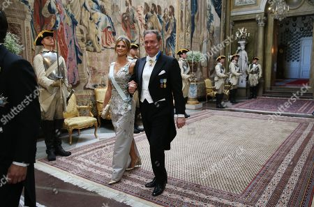 Princess Madeleine and her husband Chris O'Neill arrive for a State Banquet in honour for South Korea's presidential couple at the Royal Palace in Stockholm