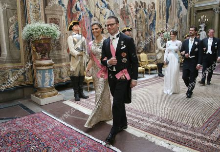 Crown Princess Victoria, Prince Daniel, Princess Sofia of Sweden, Prince Carl Philip and Chris O'Neill arrive for a State Banquet in honour for South Korea's presidential couple at the Royal Palace in Stockholm