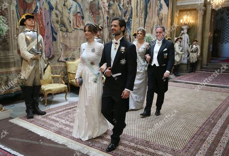 Princess Sofia of Sweden, Prince Carl Philip, Princess Madeleine and Chris O'Neill arrive for a State Banquet in honour for South Korea's presidential couple at the Royal Palace in Stockholm