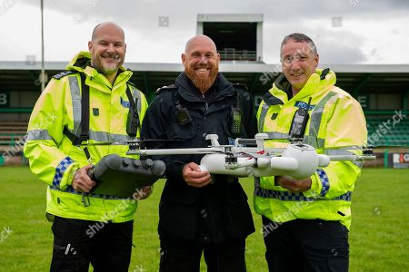 (L-R) Sargent James Bailey, Inspector Gavin Clifton and PC Tony Parker with the sky mantis drone