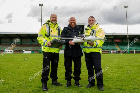 Stock Image of (L-R) Sargent James Bailey, Inspector Gavin Clifton and PC Tony Parker with the sky mantis drone