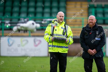 (L-R) Sargent James Bailey and Inspector Gavin Clifton in action with the sky mantis drone
