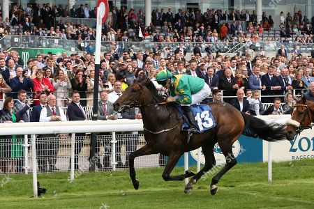 Stock Image of SHAWAAMEKH (13) ridden by David Nolan and trained by Declan Carroll winning The Irish Thoroughbred Marketing Handicap Stakes over 7f (£15,000)  during the Midsummer Raceday held at York Racecourse, York