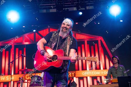 Steve Earle performs during the Grand Ole Opry show at the Bonnaroo Music and Arts Festival, in Manchester, Tenn