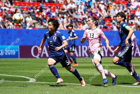 Jane Goldman (C) of Scotland in action against Nana Ichise (L) of Japan during the FIFA Women's World Cup 2019 group D soccer match between Japan and Scotland in Rennes, France, 14 June 2019.