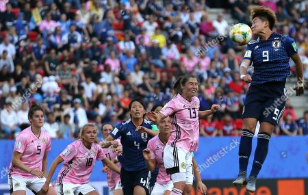Japan's Yuika Sugasawa, right, goes up against Scotland's Jane Goldman, second right, during the Women's World Cup Group D soccer match between Japan and Scotland at the Roazhon Park in Rennes, France