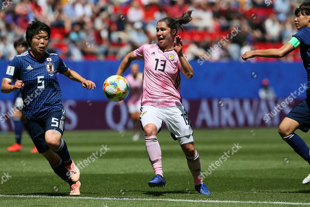 Scotland's Jane Goldman, center, is challenged by Japan's Nana Ichise, left, during the Women's World Cup Group D soccer match between Japan and Scotland at the Roazhon Park in Rennes, France