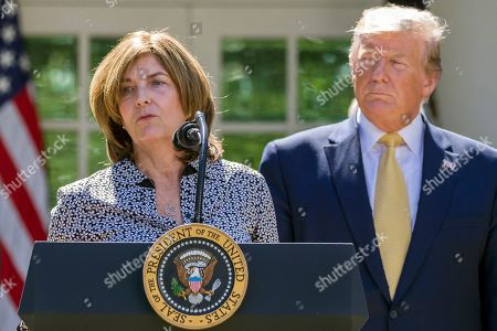 Stock Picture of Donald Trump, Andrea Burns. Andrea Burns, left, a director at Richard S. Burns and Company, Inc., of Philadelphia speaks accompanied by President Donald Trump in the Rose Garden of the White House, in Washington