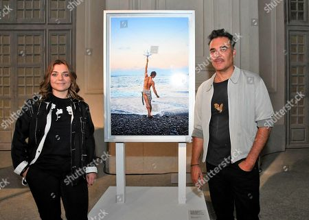Stock Picture of Francesca Lavazza and David LaChapelle iin front of one of his works 'Realize I wonder who you are (Lavazza Calendar 2020)'