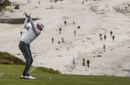 Jimmy Walker of the US hits on the ninth hole during the second round of the 119th US Open Championship at the Pebble Beach Golf Links in Pebble Beach, California, USA, 14 June 2019. The tournament is being played from 13 June to 16 June.