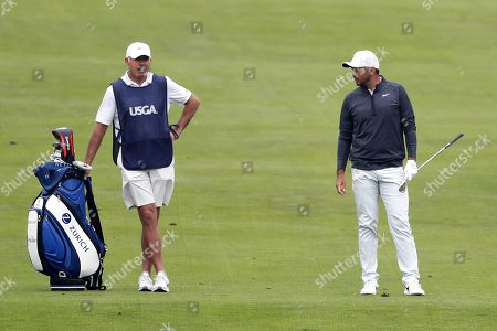 Jason Day (R) of Australia and caddie Steve Williams (L) speak with one another during the second round of the 119th US Open Championship at the Pebble Beach Golf Links in Pebble Beach, California USA, 14 June 2019. The tournament will be played 13 June thorough 16 June.