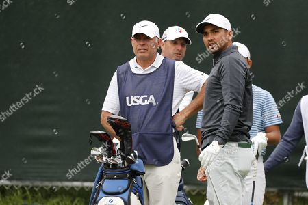 Jason Day (R) of Australia and caddie Steve Williams (L) stand at sixteen tee during the second round of the 119th US Open Championship at the Pebble Beach Golf Links in Pebble Beach, California, USA, 14 June 2019. The tournament is being played from 13 June to 16 June.