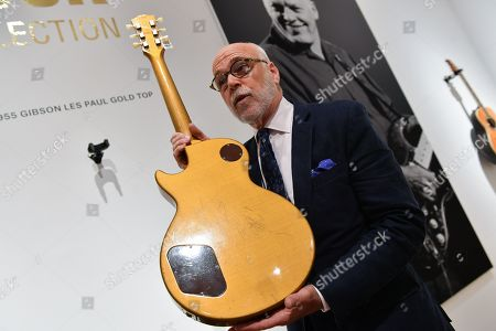 Kerry K. Keane, International Consultant for Musical Instruments, displays David Gilmour's 1955 Gibson Les Paul Gold Top guitar