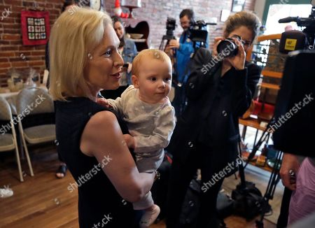 Democratic presidential candidate Sen. Kirsten Gillibrand, D-NY, holds baby Alex Murphy at a campaign meet-and-greet, in Franklin, N.H