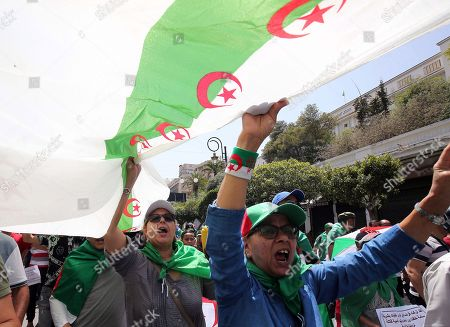Algerians protesters carry a giant national flag and shout slogans during a demonstration for the departure of the Algerian regime in Algiers, Algeria, 14 June 2019. According to media reports, former Prime Minister Abdelmalek Sellal has jailed in an anti-corruption crackdown - the second former head of government in two days to be sent to prison while his case is investigated with Algeria's Supreme Court