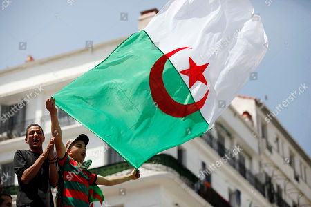 Algerians protester carries the national flag and shouts slogans during a demonstration for the departure of the Algerian regime in Algiers, Algeria, 14 June 2019. According to media reports, former Prime Minister Abdelmalek Sellal has jailed in an anti-corruption crackdown - the second former head of government in two days to be sent to prison while his case is investigated with Algeria's Supreme Court