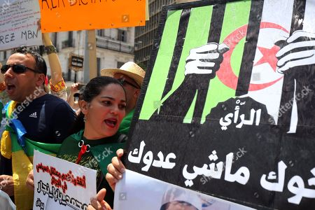 Algerians protesters carry placards and shout slogans during a demonstration for the departure of the Algerian regime in Algiers, Algeria, 14 June 2019.According to media reports, former Prime Minister Abdelmalek Sellal has jailed in an anti-corruption crackdown - the second former head of government in two days to be sent to prison while his case is investigated with Algeria's Supreme Court.