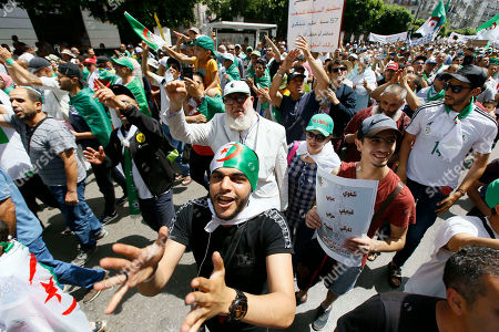 Algerian protesters gather during an anti-government demonstration in the centre of the capital Algiers, Algeria, . Algeria is in the midst of an unprecedented anti-corruption crusade, sparked by a people's revolt in February and prompting many lawmakers to be questioned over allegations, and former Algerian prime minister Abdelmalek Sellal jailed Thursday in an anti-corruption sweep