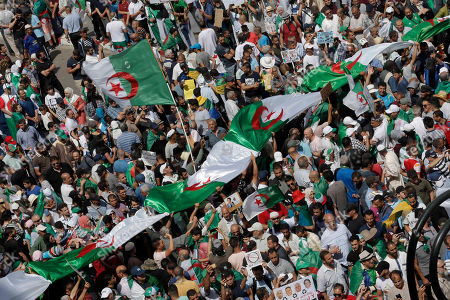 Stock Image of Algerian protesters gather during an anti-government demonstration in the centre of the capital Algiers, Algeria, . Algeria is in the midst of an unprecedented anti-corruption crusade, sparked by a people's revolt in February and prompting many lawmakers to be questioned over allegations, and former Algerian prime minister Abdelmalek Sellal jailed Thursday in an anti-corruption sweep