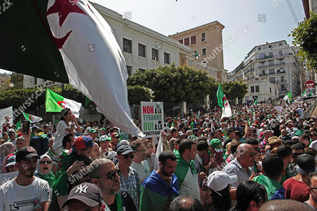 Algerian protesters gather and wave flags during an anti-government demonstration in the centre of the capital Algiers, Algeria, . Algeria is in the midst of an unprecedented anti-corruption crusade, sparked by a people's revolt in February and prompting many lawmakers to be questioned over allegations, and former Algerian prime minister Abdelmalek Sellal jailed Thursday in an anti-corruption sweep