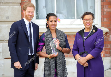 Prince Harry and Leilua Lino, one of five winners of the Commonwealth Secretary-Generals Innovation for Sustainable Development Awards with Secretary-General of the Commonwealth, The Rt. Hon Baroness Patricia Scotland QC during a garden party to celebrate the 70th anniversary of the Commonwealth at Marlborough House