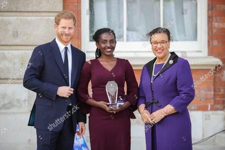 Prince Harry and Rosette Muhoza, one of five winners of the Commonwealth Secretary-Generals Innovation for Sustainable Development Awards with Secretary-General of the Commonwealth, The Rt. Hon Baroness Patricia Scotland QC during a garden party to celebrate the 70th anniversary of the Commonwealth at Marlborough House