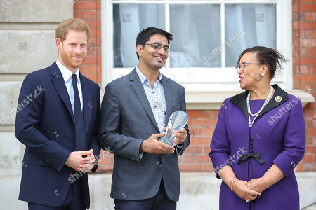 Prince Harry and Nitesh Kumar Jangir, one of five winners of the Commonwealth Secretary-Generals Innovation for Sustainable Development Awards with Secretary-General of the Commonwealth, The Rt. Hon Baroness Patricia Scotland QC during a garden party to celebrate the 70th anniversary of the Commonwealth at Marlborough House
