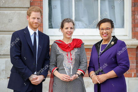 Prince Harry and one of five winners of the Commonwealth Secretary-Generals Innovation for Sustainable Development Awards, with Secretary-General of the Commonwealth, The Rt. Hon Baroness Patricia Scotland QC during a garden party to celebrate the 70th anniversary of the Commonwealth at Marlborough House