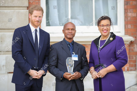 Prince Harry and Wayne Neal, one of five winners of the Commonwealth Secretary-Generals Innovation for Sustainable Development Awards with Secretary-General of the Commonwealth, The Rt. Hon Baroness Patricia Scotland QC during a garden party to celebrate the 70th anniversary of the Commonwealth at Marlborough House