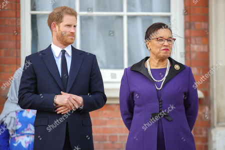 Prince Harry and Secretary-General of the Commonwealth The Rt. Hon Baroness Patricia Scotland QC during a garden party to celebrate the 70th anniversary of the Commonwealth at Marlborough House