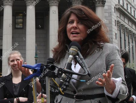 """Author and political consultant Naomi Wolf speaks to reporters during a news conference in New York. Wolf's U.S. publisher is postponing the release of her new book, """"Outrages,"""" after a BBC interviewer challenged some of her findings. Wolf is openly objecting to the delay. Houghton Mifflin Harcourt announced that """"new questions"""" had come up about """"Outrages,"""" originally scheduled to come out next week. It already has been published in the United Kingdom. On, Wolf tweeted that she made what she thought were the needed changes and that she believed her book's core findings remained valid. """"I strongly objected to this decision,"""" she wrote"""