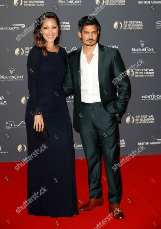 Nicholas Gonzalez (R) and Christina Chang (L) pose on the red carpet while arriving for the opening ceremony of the 59th Monte Carlo Television Festival in Monaco, 14 June 2019. The TV festival runs from 14 to 18 June.