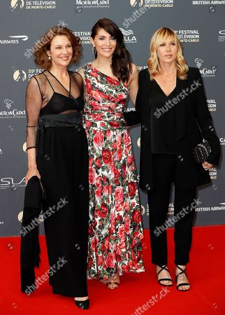 Italian actress Valeria Cavalli (L), Italian actress Caterina Murino (C) and French actress Mathilde Seigner (R) pose on the red carpet while arriving for the opening ceremony of the 59th Monte Carlo Television Festival in Monaco, 14 June 2019. The TV festival runs from 14 to 18 June.