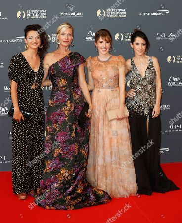French actresses Pauline Bression (L), Rebecca Hampton (2-L), Lea Francois (2-R) and Fabienne Carat (R) pose on the red carpet while arriving for the opening ceremony of the 59th Monte Carlo Television Festival in Monaco, 14 June 2019. The TV festival runs from 14 to 18 June.