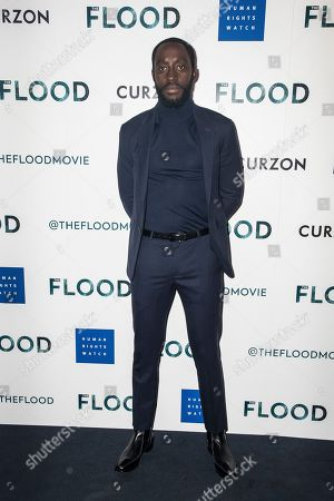 Ivanno Jeremiah poses for photographers upon arrival at the screening for 'The Flood' in London